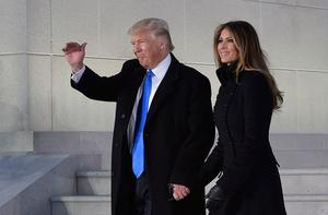 US President-elect Donald Trump and his wife Melania arrive to attend an inauguration concert at the Lincoln Memorial in Washington, DC, on January 19, 2017. / AFP PHOTO / MANDEL NGANMANDEL NGAN/AFP/Getty Images