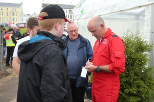 Press Eye - Belfast - Northern Ireland - 3rd September 2016 -   Squadron Leader Mike Ling from the RAF Red Arrows signs autographs at the Air Waves Portrush, Northern Ireland International Airshow. Organised by Causeway Coast and Glens Borough Council, over 100,000 spectators descended upon PortrushÕs eastern shoreline for two days of flying displays by some of the worldÕs most famous aviation attractions.  Photo by Kelvin Boyes / Press Eye