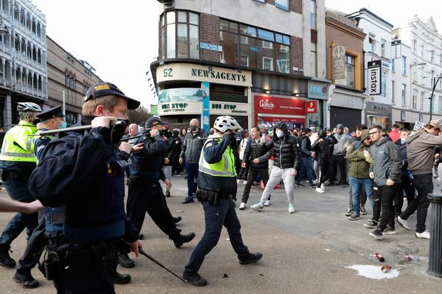 Gardai come up against protesters during an anti-lockdown protest in Dublin city centre. Photo credit: Damian Eagers/PA Wire