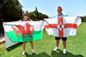 OLBIA, ITALY - JUNE 25:  Darren Clarke and Amy Boulden pose with the flags of Northern Ireland and of Wales during The Costa Smeralda Invitational golf tournament at Pevero Golf Club - Costa Smeralda on June 25, 2016 in Olbia, Italy.  (Photo by Tullio M. Puglia/Getty Images for Professional Sports Group )