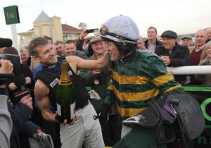 TOWCESTER, ENGLAND - NOVEMBER 07:  Tony McCoy riding Mountain Tunes is congratulated by fellow jockey Andrew Thornton after winning the Weatherbys Novices' Hurdle Race for his 4000th winner on November 7, 2013 in Towcester, England.  (Photo by Shaun Botterill/Getty Images)
