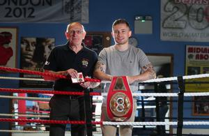 Top team: Midland ABC coach Billy McKee with his British Empire medal and Carl Frampton with his IBF super-bantam title belt