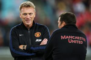 SYDNEY, AUSTRALIA - JULY 20:  Manchester United manager, David Moyes speaks with a member of the coaching staff at full time following the match between the A-League All-Stars and Manchester United at ANZ Stadium on July 20, 2013 in Sydney, Australia.  (Photo by Brendon Thorne/Getty Images)