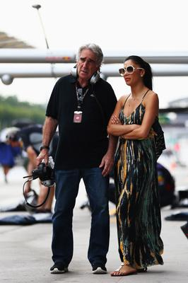 KUALA LUMPUR, MALAYSIA - MARCH 24:  Tom Shine, manager of Lewis Hamilton of Great Britain and Mercedes GP and Hamiltons girlfriend Nicole Scherzinger of the Pussycat Dolls are seen following the Malaysian Formula One Grand Prix at the Sepang Circuit on March 24, 2013 in Kuala Lumpur, Malaysia.  (Photo by Paul Gilham/Getty Images)