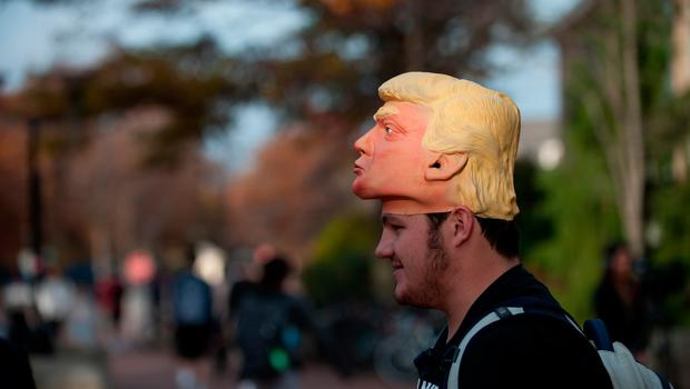 Ed Cottril, 19, of Canonsburg, PA, a freshman, stands outside the polling location on Penn State University's campus hoping to convince fellow students to vote for Donald Trump in the presidential election on November 8, 2016 in State College, Pennsylvania. Students were experiencing waits of up to 45 minutes to an hour during peak times.(Photo by Jeff Swensen/Getty Images)