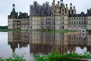 This handout picture released by the Domaine national de Chambord shows a flooded area in front of the Chateau de Chambord (the Castle of Chambord) on June 1, 2016 in Chambord as torrential downpours have lashed parts of northern Europe in recent days, leaving four dead in Germany. AFP/Getty Images