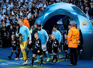 Manchester City goalkeeper Joe Hart leads his players out of the tunnel for the UEFA Champions League Quarter Final, Second Leg match at the Etihad Stadium, Manchester. Photo: Martin Rickett/PA Wire