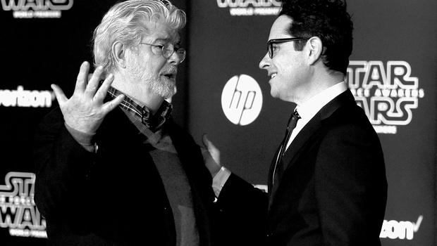"""HOLLYWOOD, CA - DECEMBER 14:  (Editors Note: Image altered using digital filters) Directors George Lucas and  J.J. Abrams attend The Premiere Of Walt Disney Pictures And Lucasfilm's """"Star Wars: The Force Awakens"""" on December 14, 2015 in Hollywood, California.  (Photo by Frazer Harrison/Getty Images)"""