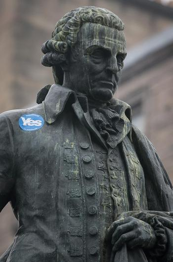 EDINBURGH, SCOTLAND - SEPTEMBER 18:  A Yes sticker is seen on the statue of Adam Smith on the Royal Mile on September 18, 2014 in Edinburgh, Scotland. After many months of campaigning the people of Scotland today head to the polls to decide the fate of their country. The referendum is too close to call but a Yes vote would see the break-up of the United Kingdom and Scotland would stand as an independent country for the first time since the formation of the Union.  (Photo by Matt Cardy/Getty Images)