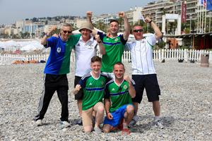 Northern Ireland fans arrive on the beach near Promenade des Anglais, Nice, France. PA
