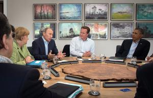 Russian President Vladimir Putin speaks as Prime Minister David Cameron holds a meeting with G8 leaders at the G8 venue of Lough Erne on June 18, 2013 in Enniskillen, Northern Ireland.  (Photo by Stefan Rousseau - WPA Pool /Getty Images)