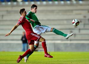 Kyle Lafferty (R) of Northern Ireland just fails to score during the Euro 2016 Group F qualifying match between Northern Ireland and Hungary at Windsor Park on September 7, 2015 in Belfast, Northern Ireland.  (Photo by Charles McQuillan/Getty Images)