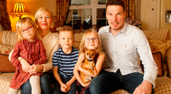 Winning team: Kyle at home with wife Lynette, children Millie, Daisy and Jackson plus pet dog Sparky