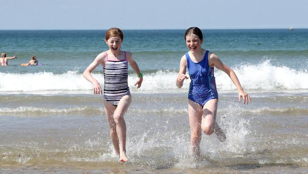 Press Eye - Weather Pictures - Portstewart Beach - 30th June 2018  Photograph by Declan Roughan  (L-R) Anna Mc Cavana aged 11 and Catherine Gaw aged 11 from both from Randalstown.