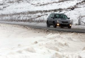 Traffic on the Glenshane Pass in Co Londonderry, as snow is replaced with rain and high winds across the province.