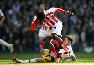 Stoke City's Mame Biram Diouf, (left) is tackled by Tottenham Hotspur's Ryan Mason, (right)  during the Barclays Premier League match at White Hart Lane, London. John Walton/PA Wire.