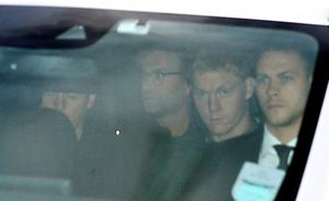 Jurgen Klopp (second left) is escorted away after arriving at John Lennon Airport, Liverpool. Thursday October 8, 2015. Photo: Peter Byrne/PA Wire.