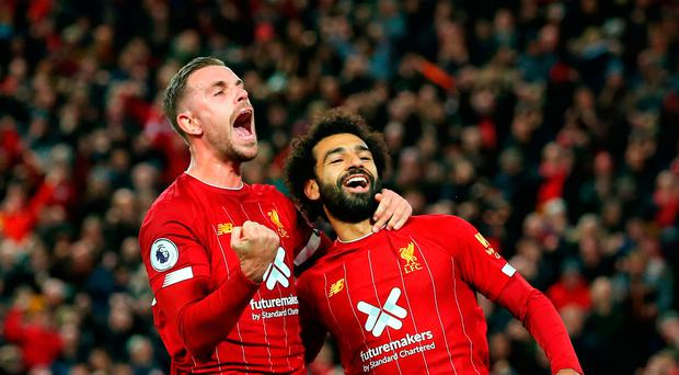 Glory boys: Mo Salah celebrates his penalty winner with Jordan Henderson, scorer of Liverpool's first goal