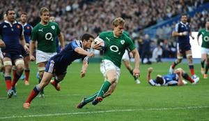 Ireland's Andrew Trimble dives in to score his side's second try during the Six Nations match at the Stade de France, Paris, France