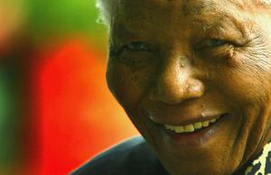 International humanitarian and former South African president, Nelson Mandela smiles as he arrives at the Queen Elizabeth II Conference Hall July 10, 2003 in London, England. Photo by Scott Barbour/Getty Images