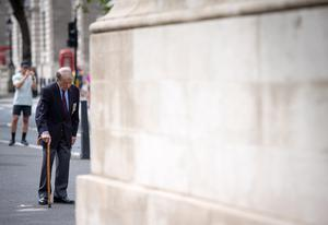Lou Myers, 92, observes two minutes' silence at the Cenotaph, in Whitehall (PA)