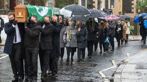 Covered with the Irish Cricket flag the funeral of cricketing  legend Roy Torrens leaves Portrush Presbyterian Church. Pictures: Martin McKeown