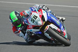 PHILLIP ISLAND, AUSTRALIA - FEBRUARY 23: Eugene Laverty of Ireland and Voltcom Crescent Suzuki in race 1 during round one of the 2014 World Superbike Championship at Phillip Island Grand Prix Circuit on February 23, 2014 in Phillip Island, Australia.  (Photo by Scott Barbour/Getty Images)