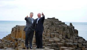 Pacemaker Press 3/7/2012  First Minister Peter Robinson and Deputy First Minister Martin McGuinness wave to the visitors  during the opening of the New Visitors centre at the Giants Causeway in Co Antrim Yesterday,  The £18.5m building has taken 18 months to complete and includes exhibition spaces, a cafe and shops. Walks and trails around the site have also been upgraded, with the addition of a new accessible cliff-top walk for families and people with disabilities .PIcture Colm Lenaghan/ Pacemaker