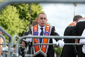 Bandsmen and members of the Orange Order pictured at a PSNI barrier at the Woodvale Road in North Belfast after the main 12th of July parades took place across Northern Ireland. Photo by Kelvin Boyes / Press Eye.