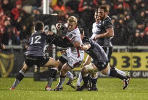 Ulster's Stuart Olding and Ospreys' Ashley Beck in action at Friday Nights game. Russell Pritchard / Presseye.