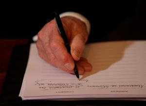 President Michael D Higgins signs a book of condolence at Mansion House in Dublin for those killed in the Berkeley balcony collapse. PRESS ASSOCIATION Photo. Picture date: Thursday June 18, 2015. See PA story IRISH Balcony. Photo credit should read: Niall Carson/PA Wire