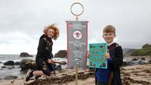 Cross and Passion College pupils Aine (11) and Oisin Franey (9) celebrated Ballycastle's new Quidditch status. Pic Press eye