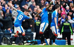 GLASGOW, SCOTLAND - APRIL 17:  Barrie McKay of Rangers celebrates team-mate James Tavernier after scoring their second goal during the William Hill Scottish Cup semi final between Rangers and Celtic at Hampden Park on April 17, 2016 in Glasgow, Scotland.  (Photo by Jeff J Mitchell/Getty Images)