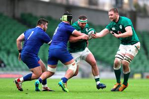 Ireland hooker Rob Herring is supported by team-mate Iain Henderson as he carries into Gregory Alldritt of France (Brian Lawless-Pool/Getty Images)
