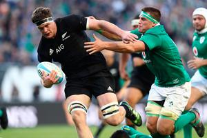 CHICAGO, IL - NOVEMBER 05:  Scott Barrett of New Zealand hands off CJ Stander of Ireland during the international match between Ireland and New Zealand at Soldier Field on November 5, 2016 in Chicago, United States.  (Photo by Phil Walter/Getty Images)