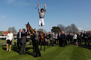 Frankie Dettori leaps in the winners enclosure after riding to win Osaila The Lanwades Stud Nell Gwyn Stakes at Newmarket racecourse on April 15, 2015 in Newmarket, England. (Photo by Alan Crowhurst/Getty Images)