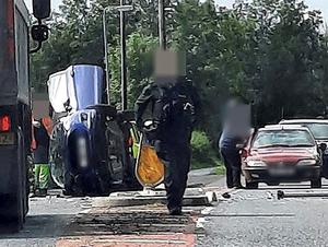 The scene at Bann Road, Ballymoney where a car ended up on its side after a crash. Picture: McAuley Multimedia