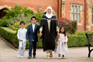 Amatul Salma graduates from Queen's with a degree in Biomedical Science. Amatul, pictured here with her children, moved to Belfast from India in 2008 to join her husband.
