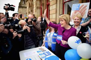RENFREW, SCOTLAND - SEPTEMBER 16:  Deputy First Minister Nicola Sturgeon meets with campaigners at Renfrew Town hall on September 16, 2014 in Renfrew, Scotland. With just two days of campaigning left before polling stations open and voters across the country will hold Scotlands future in their hands.  (Photo by Jeff J Mitchell/Getty Images)