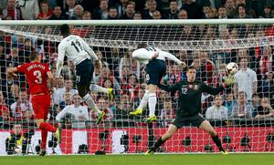 England's Wayne Rooney scores his side's first goal of the game during the FIFA 2014 World Cup Qualifying, Group H match at Wembley Stadium, London.