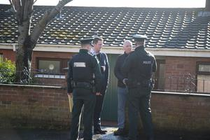 Police at the sene talk to John Finucane and his uncle Martin. Pic Kevin Scott