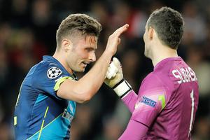 Arsenal's Olivier Giroud, left, gestures towards Monaco's goalkeeper Danijel Subasic  during their Champions League round of 16 second leg soccer match between Monaco and Arsenal at Louis II stadium in Monaco, Tuesday, March 17, 2015. (AP Photo/Christophe Ena)