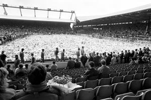 File photo dated 22/04/1989 of fans gathering at Anfield for a ceremony of remembrance following the Hillsborough disaster. The final annual Hillsborough memorial service at Anfield will take place later to mark 27 years to the day since the tragedy claimed 96 lives. PRESS ASSOCIATION Photo. Issue date: Friday April 15, 2016. Thousands of ordinary fans are expected to gather with the families of those who died in the tragedy to pay their respects one last time at the home of Liverpool FC. See PA story MEMORIAL Hillsborough. Photo credit should read: PA/PA Wire
