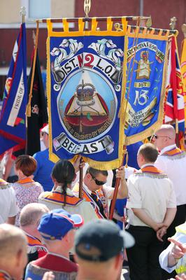 Press Eye - Belfast -  Saturday 20th July 2013   Orange supporters pictured on the Woodvale Road in Belfast afternoon attempt to parade up to the police lines.  In an unexpected move earlier this week, Orangemen made a new application to the Parades Commission adjudication body to march the disputed Crumlin Road section of the route today. That bid was again rejected by the commission - a move that is likely to prompt another stand-off between police and protesters at the same community interface area later.  The Order said it applied for Saturday's event to complete a return parade they were banned from making on the Twelfth of July.  Order members have continued to hold protests in the area throughout the week.  Picture by Kelvin Boyes / Press Eye.