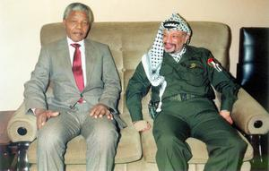 (FILE PHOTO) Former South African President Nelson Mandela Has Died Aged 95 UNDATED - FILE PHOTO In this undated file photo Palestinian leader Yasser Arafat is pictured meeting with Nelson Mandela the former leader of South Africa. Medics announced on October 31, 2004 that Arafat's health is in a serious condition, after the illness that has persisted for two weeks, took a sudden turn for the worse. Test have so far proved inconclusive and more results are expected on Wednesday. (Photo by Palestinian Authorities via Getty Images)