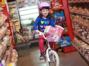 'Cerise the day'  Clodagh Wilson (7) from Cookstown was 'in the pink' as she picked up limited edition versions of the much-loved Irwin's Nutty Krust and Softee loaves. Over 1 million loaves, which are in stores now, have been given a makeover by Irwin's Bakery to celebrate the Giro D'Italia 'Big Start' in Northern Ireland. Picture by Phil Smyth