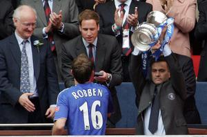 FILE - JUNE 02, 2013:  Jose Mourinho has been confirmed as Chelsea FC manager, returning to the club for a second term in charge, having left the club in 2007. LONDON - MAY 19:  Jose Mourinho manager of Chelsea lifts the FA Cup trophy as HRH Prince William gives Arjen Robben his medal following the FA Cup Final match sponsored by E.ON between Manchester United and Chelsea at Wembley Stadium on May 19, 2007 in London, England.  (Photo by Phil Cole/Getty Images)