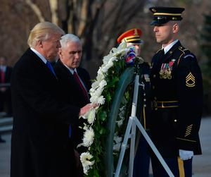 US President-elect Donald Trump and Vice President-elect Mike Pence take part in a wreath-laying ceremony at  Arlington National Cemetery in Arlington,Virginia, on January 19, 2017. / AFP PHOTO / MANDEL NGANMANDEL NGAN/AFP/Getty Images