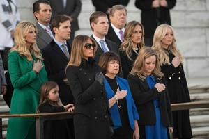 Family member watch as US President-elect Donald Trump and Vice President-elect Mike Pence take part in a wreath-laying ceremony at Arlington National Cemetery in Arlington, Virginia on January 19, 2017 / AFP PHOTO / MANDEL NGANMANDEL NGAN/AFP/Getty Images