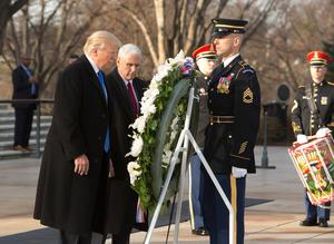 JOINT BASE ANDREWS, MD - JANUARY 19: (AFP OUT)  US President-elect Donald J. Trump and US Vice President-elect Mike Pence participate in a wreath laying ceremony at Arlington National Cemetery on January 19, 2017 in Arlington, Virginia. Hundreds of thousands of people are expected to come to the National Mall to witness Trump being sworn in as the 45th president of the United States. (Photo by Chris Kleponis-Pool/Getty Images)